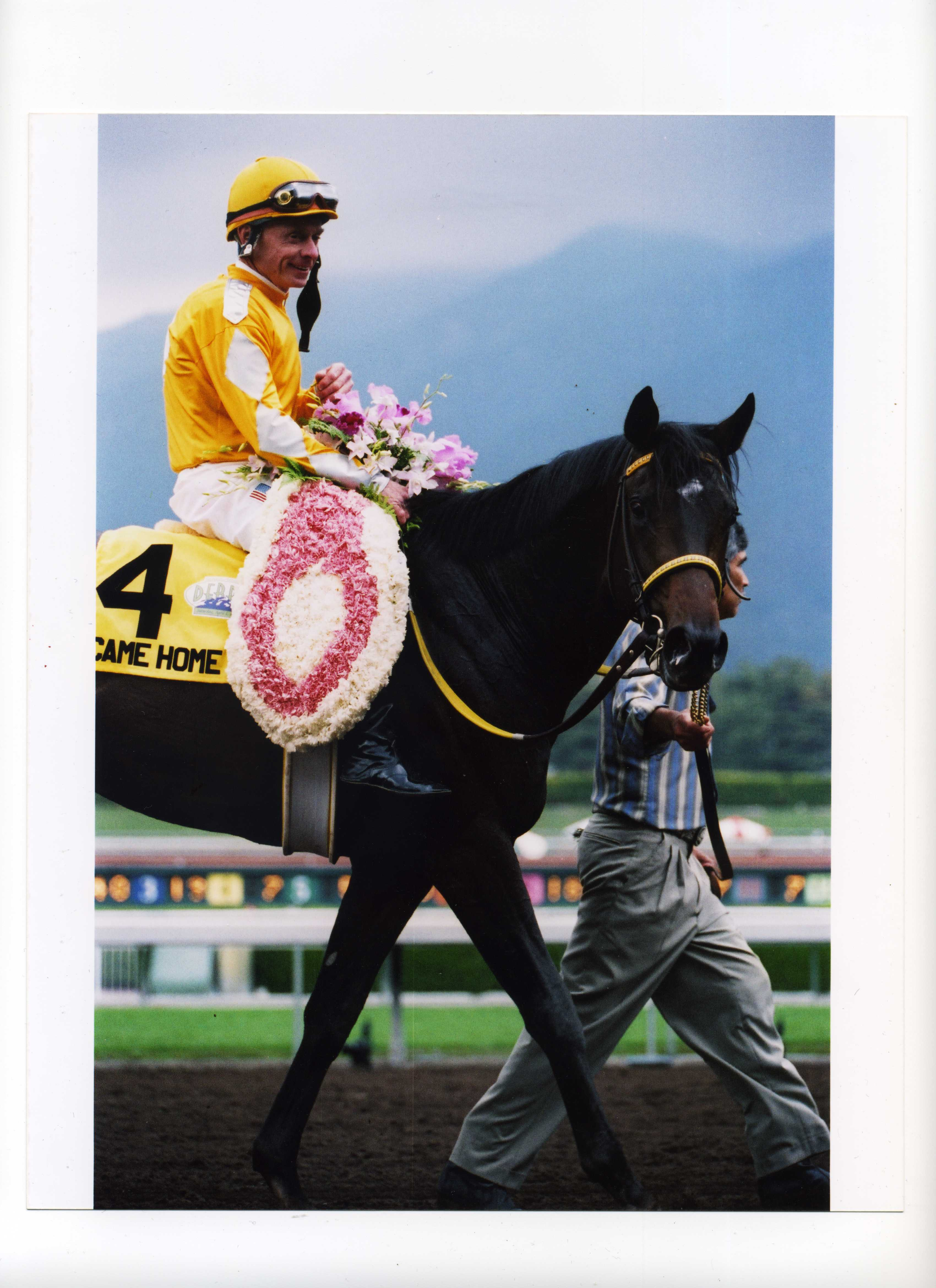Robert Taylor Brewer photographs Came Home after winning Santa Anita Handicap